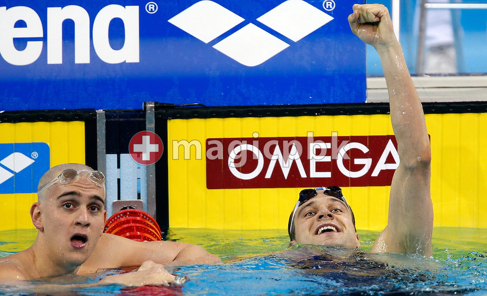 Winner Markus ROGAN (R) of Austria celebrates a new European Record in the men's 200m Individual Medley (IM) Final while Laszlo CSEH of Hungary is disappointed at the 13th European Short Course Swimming Championships in Istanbul, Turkey, Thursday, Dec. 10, 2009. (Photo by Patrick B. Kraemer / MAGICPBK)