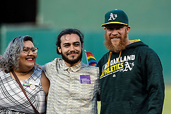 OAKLAND, CA - JUNE 14:  Sean Doolittle #62 of the Oakland Athletics meets with members of the LBGTQ community before the game against the Texas Rangers at the Oakland Coliseum on June 14, 2016 in Oakland, California. The Texas Rangers defeated the Oakland Athletics 10-6. (Photo by Jason O. Watson/Getty Images) *** Local Caption *** Sean Doolittle