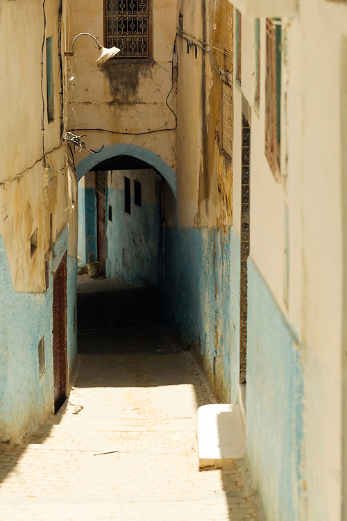 Moulay Idriss Zerhoun Medina, Middle Atlas, Morocco, 2016-08-13.<br /><br />Located nearby to Meknes and spread across the slopes of Jebel Zerhoune, Moulay Idriss holds a sacred aspect for many Moroccans; it is the burial place for Moulay Idriss the I who originally brought the religion of Islam to Morocco. The large green tiled mausoleum and mosque is located at the centre of it's Medina, which is located only 3km away from the UNESCO protected Volubilis Roman ruins.