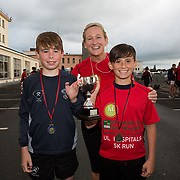 25.08. 2017.                                                                          <br /> Almost 200 UL Hospitals Group staff, past and present, and members of the public completed the annual 5k Charity Run/Walk on Friday August 25th in Limerick.<br /> <br /> Mairead Cowan, Directorate Nurse Manager, Medicine Directorate presented the trophy for first juveniles home, Evan Bennett and Jack Corbett.<br /> <br /> <br /> Everybody who participated also raised funds for Friends of Ghana, an NGO formed last year by UL Hospitals Group and its academic partner the University of Limerick to deliver medical training programmes in the remote Upper West Region of Ghana. Picture: Alan Place
