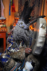 Mongolian Shaman Batgerel Batmunkh performs a Shaman ceremony summoning the white spirit in their ger on the outskirts of Ulan Bator, Mongolia, 04 July 2012. Mongolian brothers Gankhuyag and Batgerel Batmunkh share a similar fate. Both were construction workers before fate calls on them to take on their Shamanic roles to serve the spirits. Shamanism comes from the term 'shamans' that refers to priests or mediums that acts as vessels for spirits, gods and demons to communicate with the human world. In Mongolia, they adhere to the ancient beliefs of Tengrism, where spirits live in all of nature, in the sun, moon, lakes, rivers, mountains, and trees.