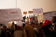 Protestors march in the main square of Tabrurk demanding Qadaffi to leave on Feb. 24, 2011. The square has become a symbol of New Libya, tents have been set up, people are giving out free food, and heavy equiptment is being used to repair the square.