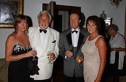 Left to right, PETA ELLIOTT, RAY WILLIAMS, TONY GRAVENOR and his wife FRANCES GRAVENOR at a charity dinner hosted by Jennie Hallam-Peel to promote the London Debutante Season held at her home Somerhill, Rowdean Crescent, Brighton on 12th September 2004.