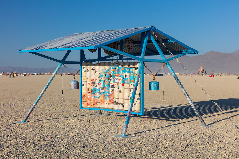 """Puzzles and Prayers- Reinventing the Prayer Wheel<br /> by: Gwen Darling with Gwen and Josh Art<br /> from: Santa Cruz, CA & Reno, NV<br /> year: 2019<br /> <br /> """"Puzzles and Prayers"""" is a large scale interactive mixed media sculpture serving as a shaded gathering space for participants to explore, discover, to pray and play. Prayer wheels are typically seen as individual wheels aligned in long rows, but the """"Puzzles and Prayers"""" wheel components will be arranged in a grid. Each ceramic wheel will be a puzzle piece. When spun into alignment with the rest, the wheels will compose a beautiful mural. It will give the participant a unique opportunity to interact with this spiritual tradition as well as discovering the hidden image of the contemporary mural.<br /> <br /> URL: https://hairypotter1008.wixsite.com/website<br /> Contact: puzzlesandprayers@gmail.com<br /> <br /> https://burningman.org/event/brc/2019-art-installations/?yyyy=&artType=H#a2I0V000001AVvhUAG My Burning Man 2019 Photos:<br /> https://Duncan.co/Burning-Man-2019<br /> <br /> My Burning Man 2018 Photos:<br /> https://Duncan.co/Burning-Man-2018<br /> <br /> My Burning Man 2017 Photos:<br /> https://Duncan.co/Burning-Man-2017<br /> <br /> My Burning Man 2016 Photos:<br /> https://Duncan.co/Burning-Man-2016<br /> <br /> My Burning Man 2015 Photos:<br /> https://Duncan.co/Burning-Man-2015<br /> <br /> My Burning Man 2014 Photos:<br /> https://Duncan.co/Burning-Man-2014<br /> <br /> My Burning Man 2013 Photos:<br /> https://Duncan.co/Burning-Man-2013<br /> <br /> My Burning Man 2012 Photos:<br /> https://Duncan.co/Burning-Man-2012"""