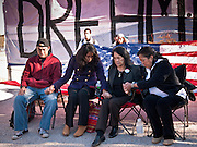 "07 DECEMBER 2010 - PHOENIX, AZ:  DOLORES HUERTA, second from right, joins other DREAM Act protesters in prayer during a fast in front of the offices of US Sen. John McCain Tuesday.  Huerta, who started working in the civil rights movement in the 1960's, threw her support behind students fasting on behalf of the DREAM Act in front of Sen. John McCain's office Tuesday. The student picked McCain's office because he used to support the DREAM Act. They hope that the US Senate will pass the DREAM Act during its ""lame duck"" session. The Senate debated and defeated similar legislation just before the November general election.  PHOTO BY JACK KURTZ"