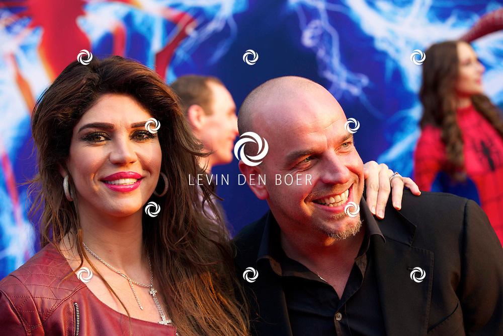 AMSTERDAM - Bij het Pathe ArenA Theater is de filmpremière van Spiderman II gehouden. Met hier op de foto  Andy van der Meyden en zijn partner Melisa Schaufeli. FOTO LEVIN DEN BOER - PERSFOTO.NU