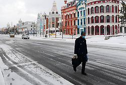 MOHE, April 19, 2020  A man walks against snowfall in Mohe City, northeast China's Heilongjiang Province, April 19, 2020. A snowfall swept Mohe, China's northernmost city, on Sunday. (Photo by Chu Fuchao/Xinhua) (Credit Image: © Chu Fuchao/Xinhua via ZUMA Wire)