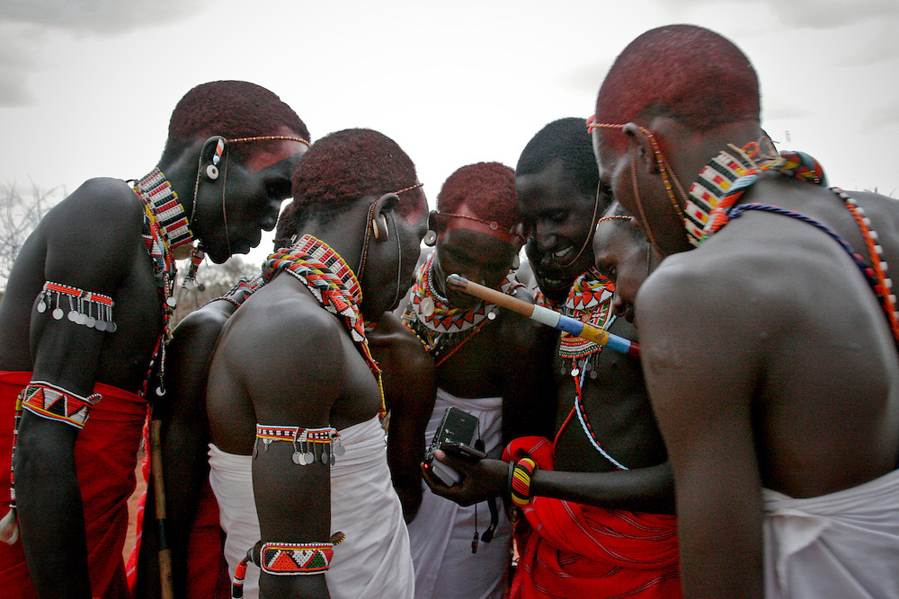 Moments after I filmed them, Samburu tribesmen in Northern Kenya watch a high definition video of themselves.