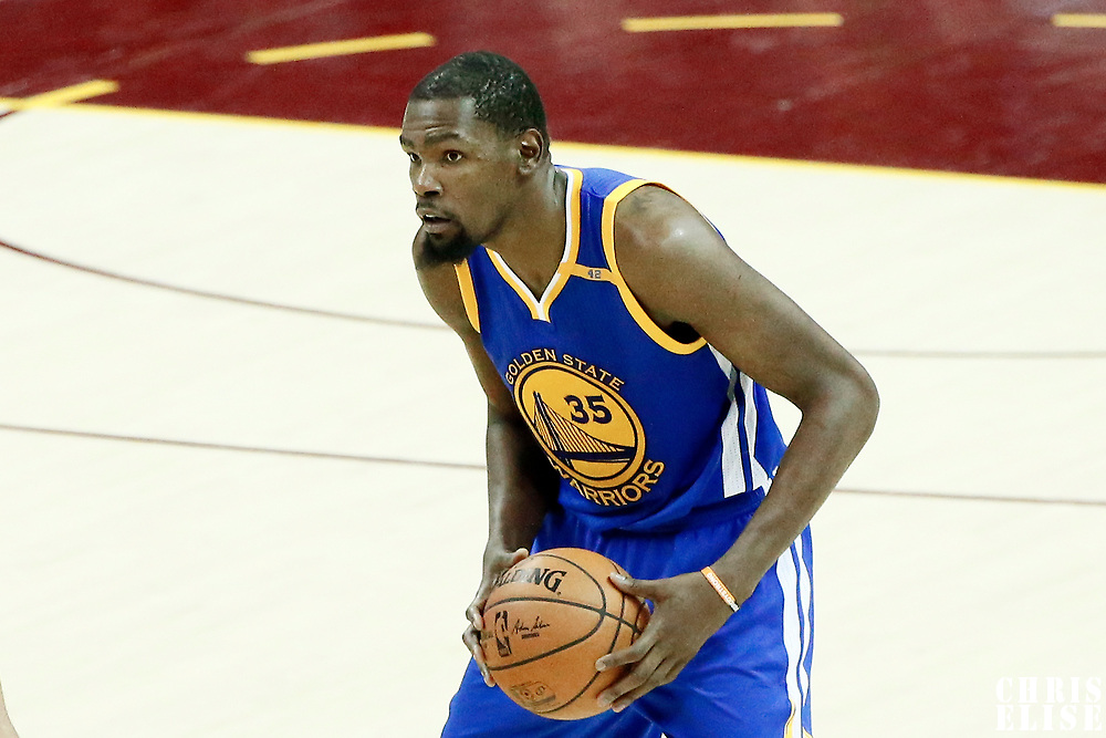 09 June 2017: Golden State Warriors forward Kevin Durant (35) looks to pass the ball during the Cleveland Cavaliers 137-11 victory over the Golden State Warriors, in game 4 of the 2017 NBA Finals, at  the Quicken Loans Arena, Cleveland, Ohio, USA.