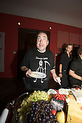 Presentation of Salon 2008 magazine at Rudolf Budja Galerie. A photographer with a funny t-shirt at the buffet.