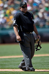 OAKLAND, CA - JULY 23:  MLB umpire Marvin Hudson #51 stands on the field during the ninth inning between the Oakland Athletics and the Toronto Blue Jays at O.co Coliseum on July 23, 2015 in Oakland, California. The Toronto Blue Jays defeated the Oakland Athletics 5-2. (Photo by Jason O. Watson/Getty Images) *** Local Caption *** Marvin Hudson