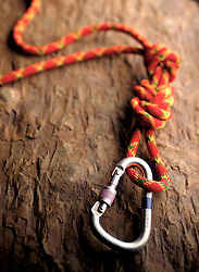climbing rope carabiner on rock surface