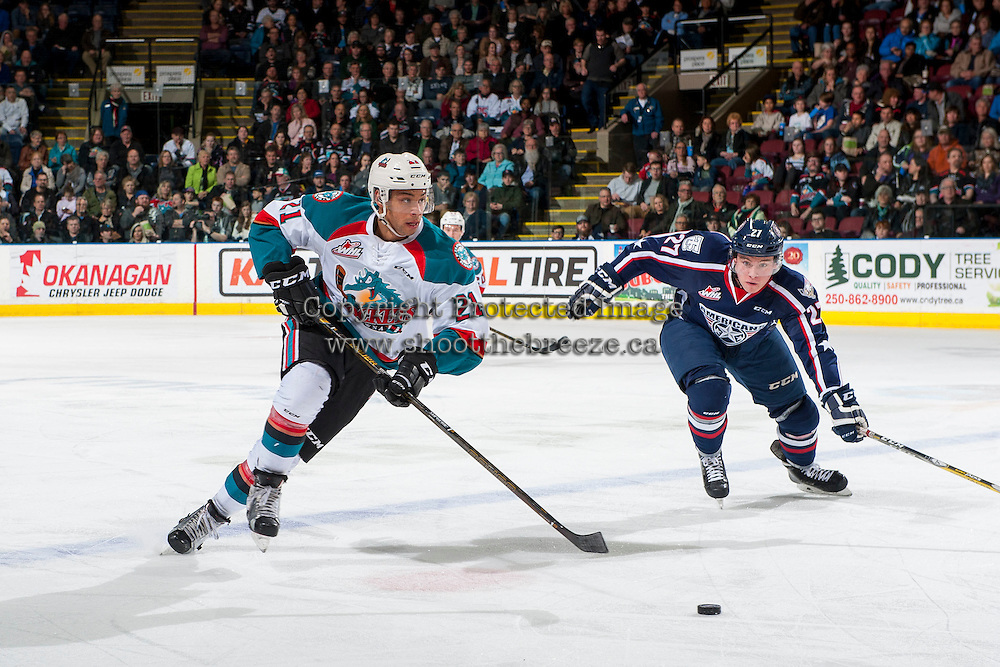 KELOWNA, CANADA - MARCH 4: Keltie Jeri-Leon #27 of the Tri-City Americans checks Devante Stephens #21 of the Kelowna Rockets as he skates with the puck up the ice during second period on March 4, 2017 at Prospera Place in Kelowna, British Columbia, Canada.  (Photo by Marissa Baecker/Shoot the Breeze)  *** Local Caption ***