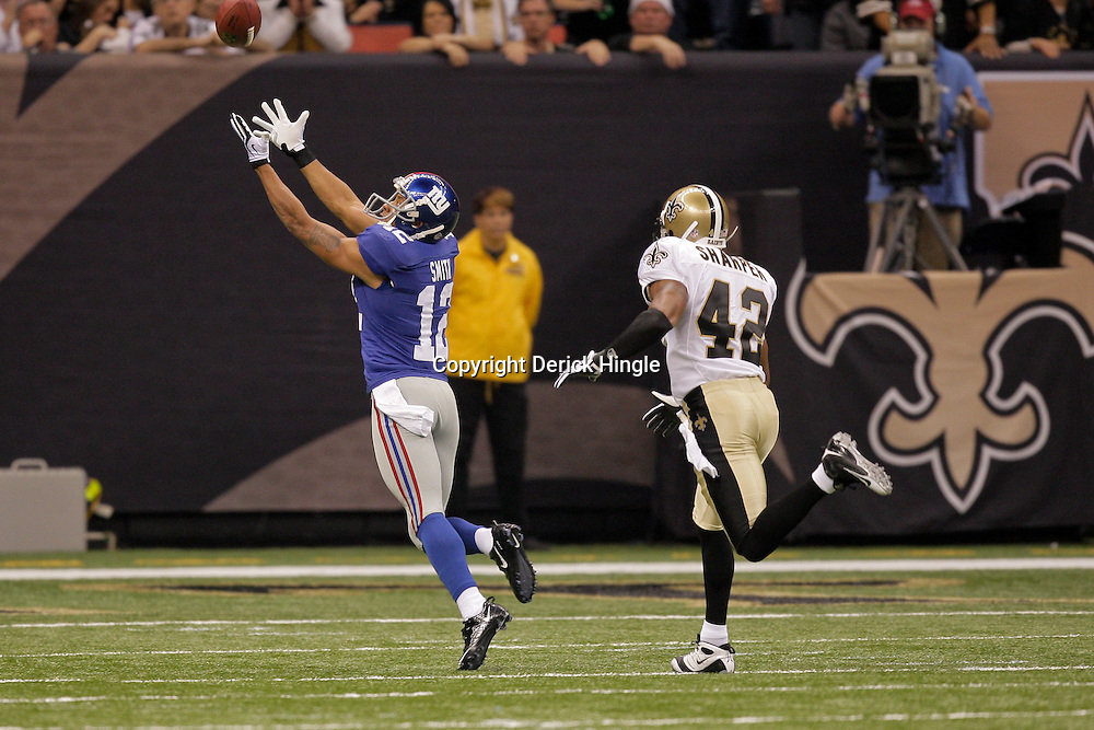 2009 October 18: New York Giants wide receiver Steve Smith (12) reaches out for a pass as New Orleans Saints safety Darren Sharper (42) covers the play with fell incomplete during the first quarter at the Louisiana Superdome in New Orleans, Louisiana.