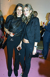 Left to right, CARLA OTTO and KIM HERSOV at a dinner hosted by Harpers Bazaar to celebrate the launch of the fragrance Flowerbomb by Viktor & Rolf held at Elms lester, Flitcroft Street, London WC2 on 31st May 2006.<br />