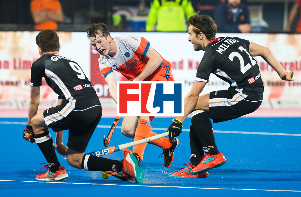 BHUBANESWAR - Seve van Ass (Ned) met Marco Miltkau (Ger) en Johannes Grosse (Ger)  tijdens de Hockey World League Finals , de kwartfinale wedstrijd Duitsland-Nederland (3-3).Duitsland wint na shoot-outs.    COPYRIGHT KOEN SUYK
