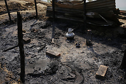 March 27, 2019 - Naogaon, Bangladesh - A view of a recent burnt house of landless indigenous people in a village of Dhamoirhat, Naogaon district northern part of Country.  A group of miscreant attacks vandalism and set fire to sleeping indigenous people's home on 25th night on the charge of possession of land. (Credit Image: © MD Mehedi Hasan/ZUMA Wire)