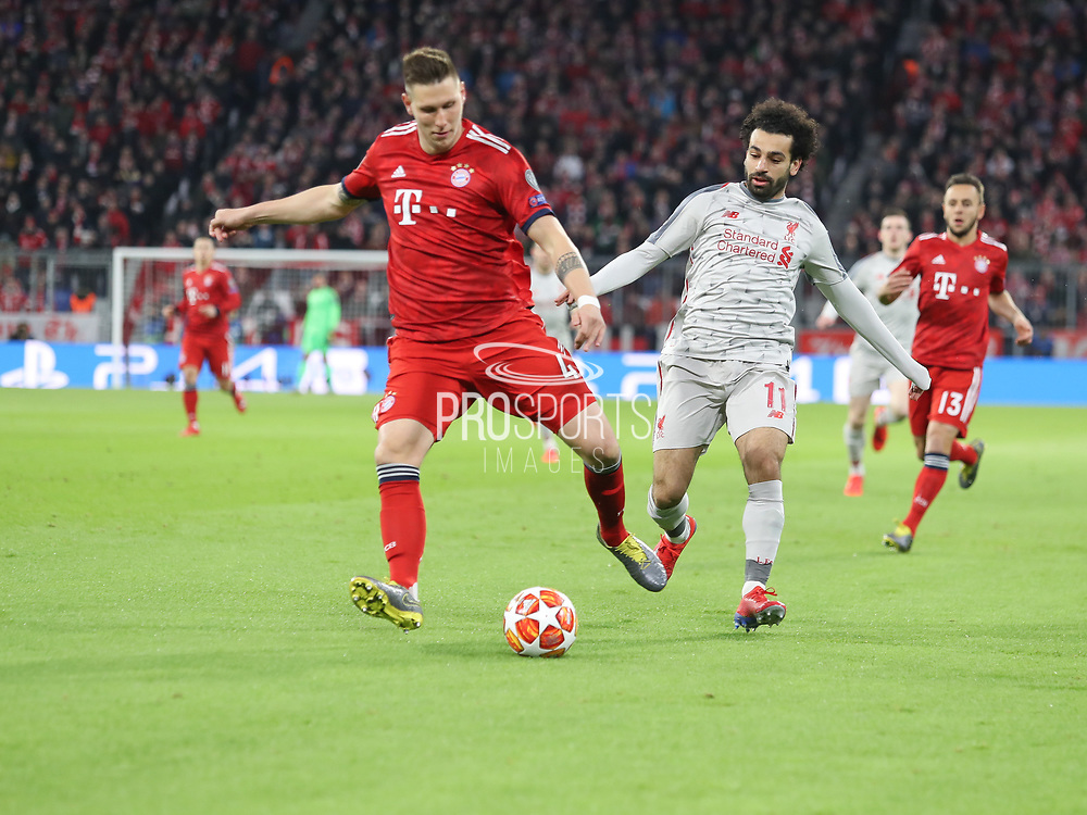 Niklas Süle of Bayern Munich against Mohamed Salah of Liverpool during the Champions League round of 16, leg 2 of 2 match between Bayern Munich and Liverpool at the Allianz Arena stadium, Munich, Germany on 13 March 2019.