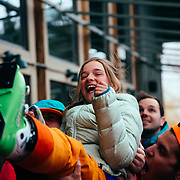 Twenty Canadians toss Jade Goodrich up in the air apres ski at the Mangy Moose in Teton Village, Wyoming.