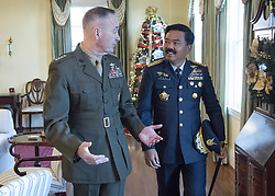 December 17, 2018 - Washington, DC, United States of America - Chairman of the Joint Chiefs Gen. Joseph Dunford, left, walks with Indonesian Air Chief Marshall Hadi Tjahjanto, Commander of the Indonesian National Armed Forces, during a coffee at his home December 11, 2018 in Washington, DC. (Credit Image: © Dominique A. Pineiro via ZUMA Wire)