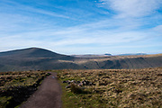 Landscape view across Brecon Beacon National Park mountain range towards Heol Senni from Pen Y Fan, Brecon Beacons, Wales, Powys, United Kingdom.  Pen Y Fan is the highest point in the Brecon Beacons hill and mountain range in South Wales. The National Park was established in 1957 due to the spectacular landscape which is rich in natural beauty.  There is a path to guide walkers to the summit of the mountain.  (photo by Andrew Aitchison / In pictures via Getty Images)