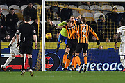 Leeds United goalkeeper Felix Wiedwald (13) and Hull City defender Michael Dawson (21) with Hull City midfielder Jackson Irvine (4) during the EFL Sky Bet Championship match between Hull City and Leeds United at the KCOM Stadium, Kingston upon Hull, England on 30 January 2018. Photo by Ian Lyall.