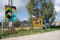 on the left of the poster is Hassan Nasrallah Hezbollahs  current political leader, on the right is Sheikh Mohammed Hussein Fadlallah, hezbollahs current spiritual leader...