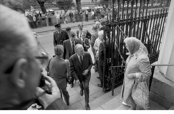 Mass For The 26th Dail.     (T3)..1989..29.06.1989..06.29.1989..29th June 1989..After the General Election  a mass took place today at the Pro-Cathedral in Dublin. The mass was to bless   the incoming TD's who were successful in their election to the Dáil...Image shows An Taoiseach, Charles Haughey TD,is welcomed on the steps of the Pro-Cathedral by a lady supporter.