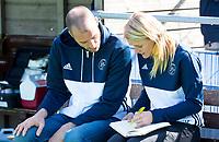 AMSTELVEEN -  coaches Jesse Mahieu en Marieke Dijkstra van Pinoke   tijdens de hoofdklasse competitiewedstrijd heren hockey Pinoke-Kampong (1-4) .   COPYRIGHT KOEN SUYK