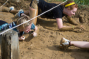 Participants crawl through the mud at the old Army ROTC training course located at the Ridges during the O'Bleness Race for a Reason Mud Run, Saturday, April 27, 2013. The course included a four-mile run up to the old Army ROTC Course at the Ridges, through the Radar Hill Trail and back to Tail Great Park across from Peden Stadium. Race for a Reason, Race 4 A Reason, Annual Events, Events, Students, Faculty & Staff