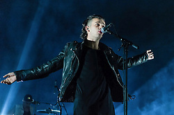 """© Licensed to London News Pictures. 09/01/2014. London, UK.   The 1975 performing live at Brixton Academy.  In this picture - Matthew Healy. The 1975 are an English alternative rock/indie rock band from consisting of members Matthew Healy (vocals, guitar), Adam Hann (guitar), George Daniel (drums), and Ross MacDonald (bass).  They are touring to promote their debut studio album """"The 1975"""".  Photo credit : Richard Isaac/LNP"""