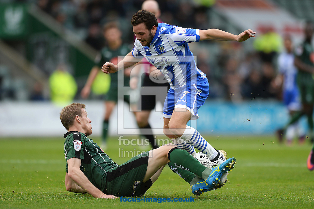 Drey Wright of Colchester United does battle with Nauris Bulvītis of Plymouth Argyle during the Sky Bet League 2 match between Plymouth Argyle and Colchester United at Home Park, Plymouth<br /> Picture by Richard Blaxall/Focus Images Ltd +44 7853 364624<br /> 29/10/2016