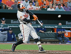 August 28, 2017 - Baltimore, MD, USA - Baltimore Orioles' Adam Jones connects for a solo homer against the Mariners in the fifth inning Monday, Aug. 28, 2017 at Oriole Park at Camden Yards in Baltimore, Md. (Credit Image: © Kenneth K. Lam/TNS via ZUMA Wire)