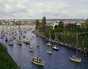 BI28,657-01...WASHINGTON - A 1965 photograph of 1000 assorted boats in Seattle's Yacht Parade on the opening day of boating season in the Lake Washington Ship Canal.