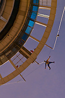 Jumper dropping from the Sky Jump atop the 328 meter high Sky Tower (the tallest free-standing structure in the Southern Hemisphere), Auckland, New Zealand