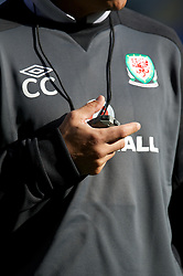 CARDIFF, WALES - Monday, October 15, 2012: Wales' manager Chris Coleman with a stop-watch during a training session at the Cardiff City Stadium ahead of the Brazil 2014 FIFA World Cup Qualifying Group A match against Croatia. (Pic by David Rawcliffe/Propaganda)