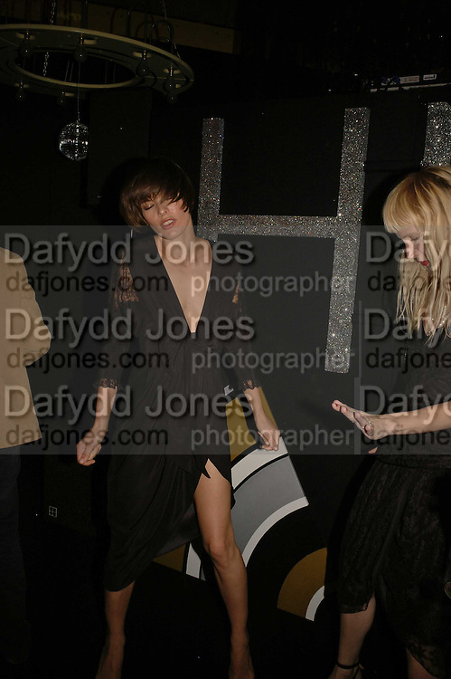Milla Jovavich, MILLA JOVOVICH, CARMEN HAWK & HARVEY NICHOLS CELEBRATE THE LAUNCH OF JOVOVICH-HAWK. FIFTH FLOOR CAFƒ. HARVEY NICHOLS. london.  27 April 2006. ONE TIME USE ONLY - DO NOT ARCHIVE  © Copyright Photograph by Dafydd Jones 66 Stockwell Park Rd. London SW9 0DA Tel 020 7733 0108 www.dafjones.com