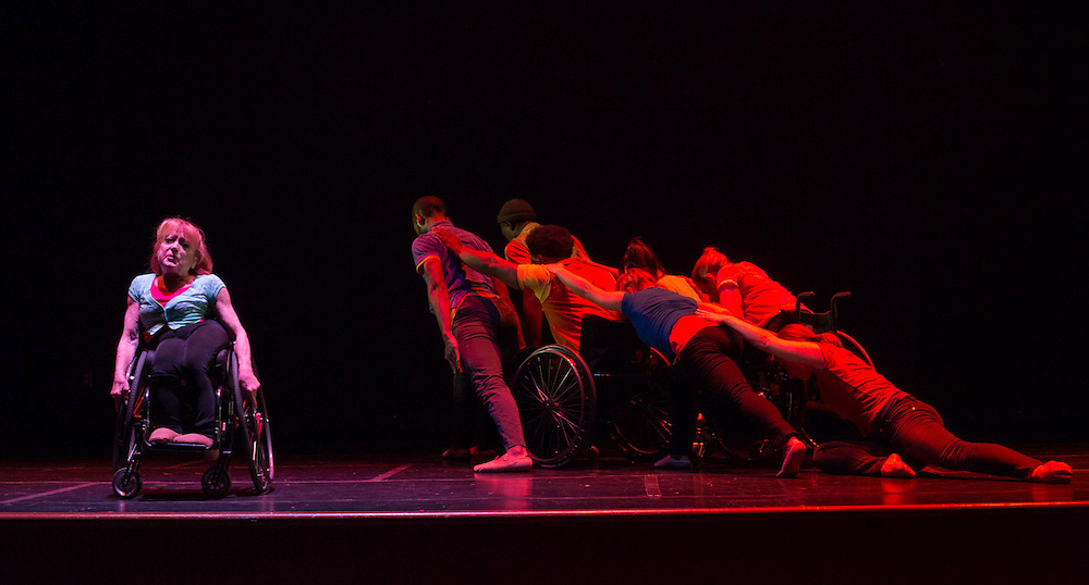 Mary Verdi-Fletcher, the founder and artistic director of Dancing Wheels Dance Troupe, left, performs with other dancers in the troupe in Baker Theater at Ohio University on October 13, 2015. Photo by Emily Matthews