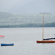 Four sailboats moored off Beaumaris on the island of Anglesey of the north coast of Wales, UK.