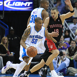 06 February 2009:  New Orleans Hornets guard Antonio Daniels (50) drives past Toronto Raptors guard Anthony Parker (18) during a NBA game between the New Orleans Hornets and the Toronto Raptors at the New Orleans Arena in New Orleans, LA.