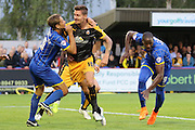 Paul Robinson of AFC Wimbledon, Tom Elliott of AFC Wimbledon, Barry Corr during the Sky Bet League 2 match between AFC Wimbledon and Cambridge United at the Cherry Red Records Stadium, Kingston, England on 18 August 2015. Photo by Stuart Butcher.