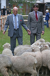 © Licensed to London News Pictures. 05/10/2015. London, UK.  ALEX JAMES (R) joins NICHOLAS COLERIDGE for the launch of Wool Week 2015 as Savile Row is transformed with sheep and grass.  Photo credit: Peter Macdiarmid/LNP