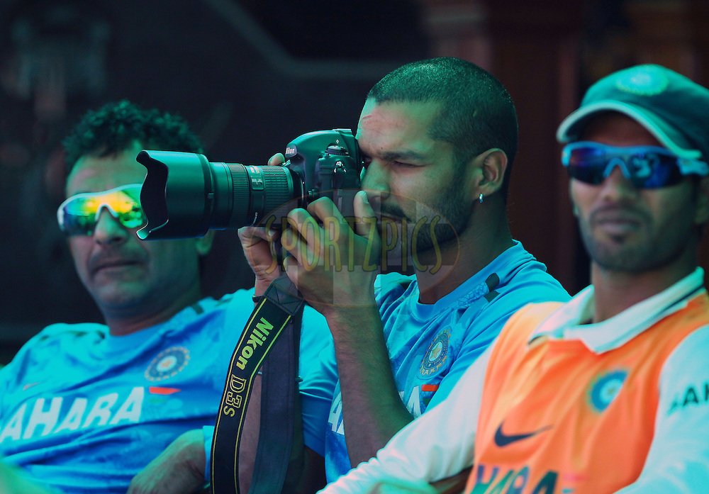 Shikhar Dhawan of India takes a few snaps with a photographers camera during day 4 of the 3rd Airtel Test Match between India and Australia held at the PCA Stadium, Mohali, India on the 17th March 2013..Photo by Ron Gaunt/BCCI/SPORTZPICS ..Use of this image is subject to the terms and conditions as outlined by the BCCI. These terms can be found by following this link:..http://www.sportzpics.co.za/image/I0000SoRagM2cIEc