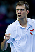 Jerzy Janowicz of Poland reacts after winning point at men's single game during the BNP Paribas Davis Cup 2014 between Poland and Croatia at Torwar Hall in Warsaw on April 6, 2014.<br /> <br /> Poland, Warsaw, April 6, 2014<br /> <br /> Picture also available in RAW (NEF) or TIFF format on special request.<br /> <br /> For editorial use only. Any commercial or promotional use requires permission.<br /> <br /> Mandatory credit:<br /> Photo by &copy; Adam Nurkiewicz / Mediasport