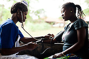 A nurse trainee checks a pregnant woman's blood pressure during a prenatal clinic at the UBC hospital in Mattru Jong, Sierra Leone on Friday April 23, 2010.