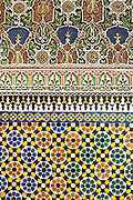 Fez, Morocco - 3rd FEBRUARY 2018 - Colourful Moroccan zellige mosaic tiling and intricate stone carving wall texture detail, old Fez Medina, Morocco.