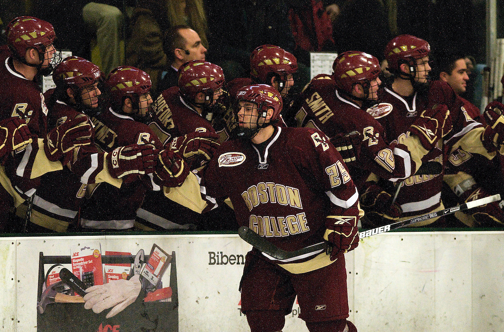 09 January 2009: Eagles forward Matt Price #25 celebrates a goal with the bench during the game in which the Vermont Catamounts and the Boston College Eagles skate to a tie in overtime 3-3 at Gutterson Fieldhouse in Burlington, Vermont.