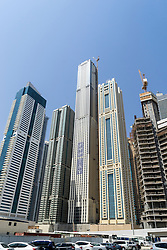 Skyline of skyscrapers with world's tallest apartment building under construction, centre, in Marina district of Dubai United Arab Emirates