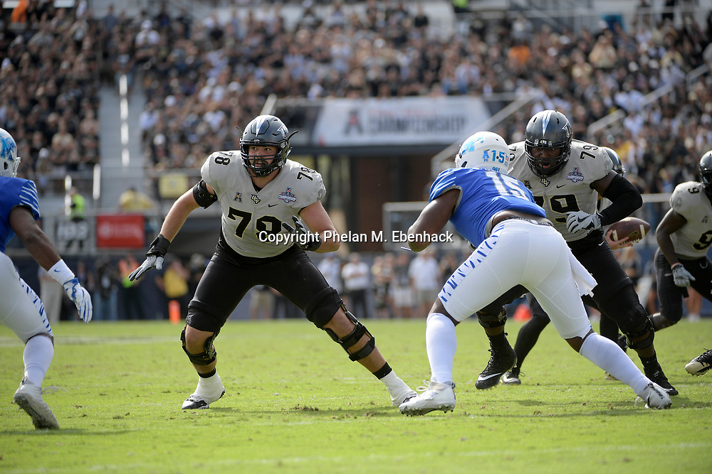 Central Florida offensive lineman Wyatt Miller (78) and offensive lineman Chavis Dickey (79) set up to block against Memphis linebacker Bryce Huff (55), left, and defensive lineman Christian Johnson (15) during the first half of the American Athletic Conference championship NCAA college football game Saturday, Dec. 2, 2017, in Orlando, Fla. (Photo by Phelan M. Ebenhack)