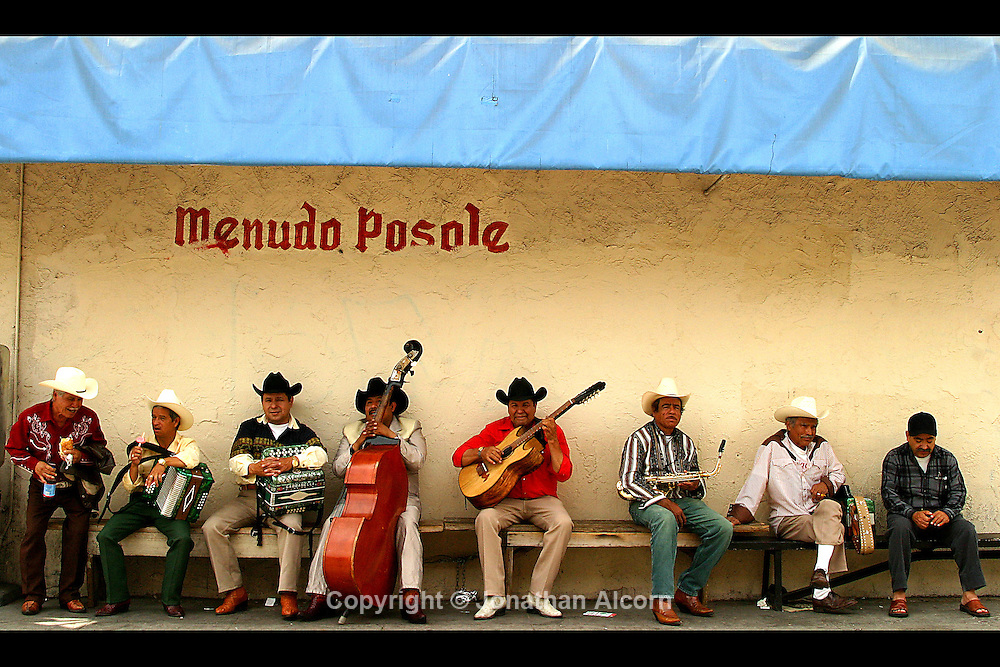 Mariachis gather near Cesar Chavez Blvd in East Los Angeles, California near Mariachi Plaza.